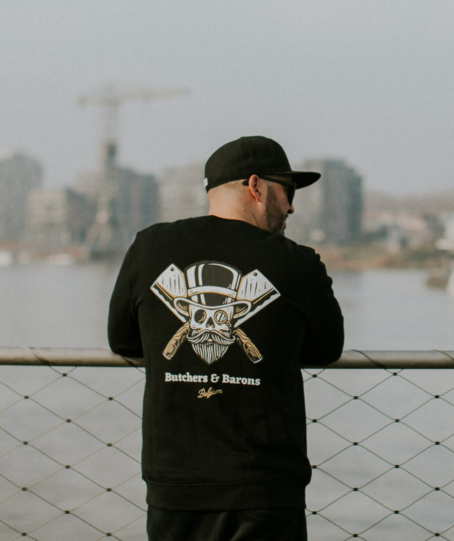 Loyalty black sweater by Butchers & Barons with skull, beard and monocle.